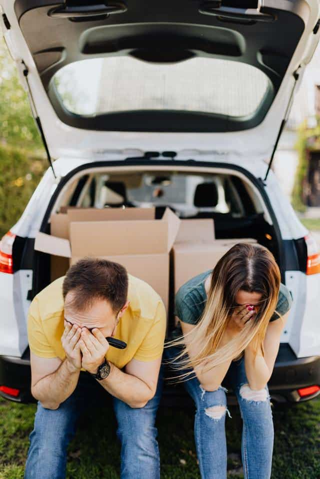 Couple Struggling in Trunk of Car